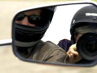 "Dr. Ellen was riding in the back seat of this motorcycle, looking directly into the mirror for a ""selfie"""