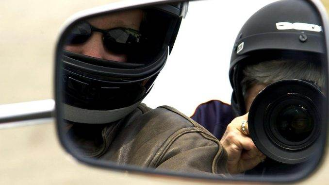 """Dr. Ellen was riding in the back seat of this motorcycle, looking directly into the mirror for a """"selfie"""""""