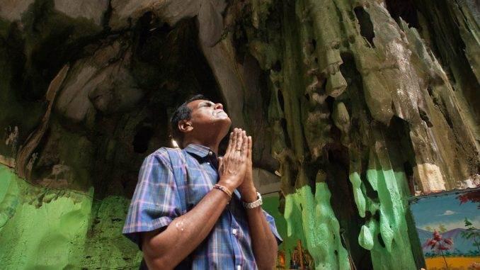 Thaipusam, a journey of Faith. man praying