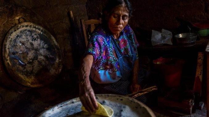 Cooking hand-made tortillas at home in Zinacantan, Chiapas