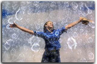Creative photography: Girl dancing in the rain by Jim Austin.