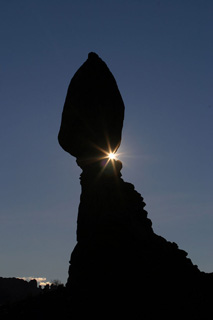 Silhouette photo of a balanced rock