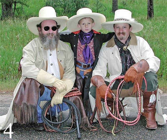 Photo of cowboys holding whips near Evergreen, Colorado by Jim Austin.