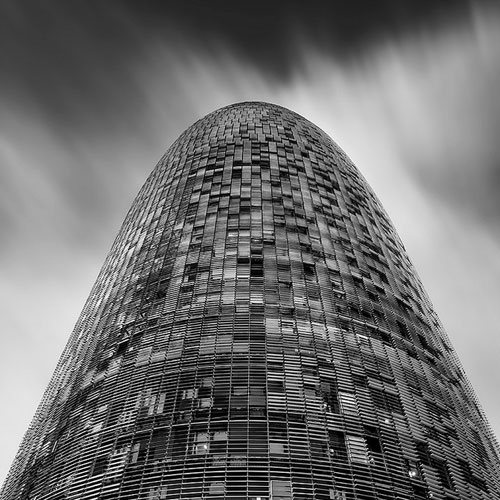 Black and white photo of Torre Agbar in Barcelona by Geoffrey Gilson.