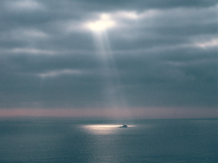 Photo of rays of light on a boat in the ocean off Maui, Hawaii by Ron Veto