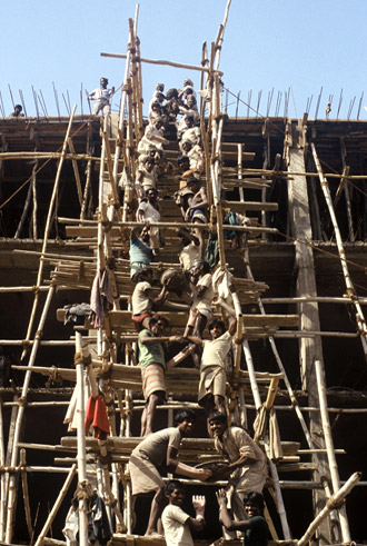 Photo of workers on scaffold in New Dehli, India by Ron Veto