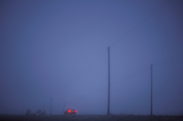 Photo of car tail lights in country fog by Gert Wagner