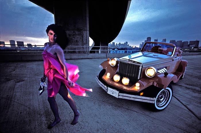Photo of woman and sports car on stormy San Francisco evening by Gert Wagner