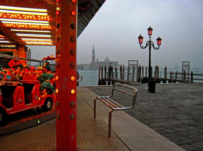 Photo of red carousel and foggy Venetian background by Gert Wagner