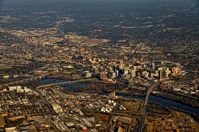 Aerial Photography: cityscape showing skysrapers, bridgess and river by Allen Moore.