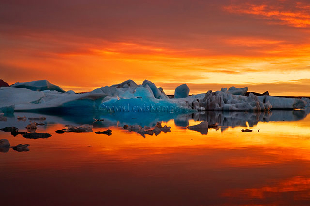 Sunset landscape image of iceberg during autumn in Iceland by Lewis Kemper.