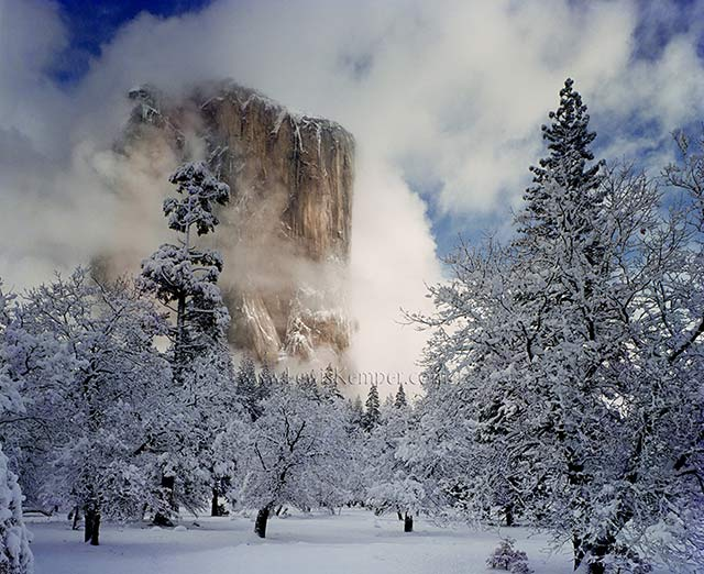 Landscape image of light on El Capitan in the winter, Yosemite National Park, California by Lewis Kemper.