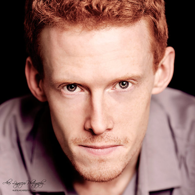 Close-up headshot of a red haired man looking straight into the camera by Alex Lagarejos.