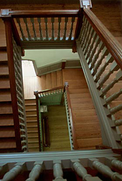 Wood staircase with the element of lines coming from different directions by Andy Long.