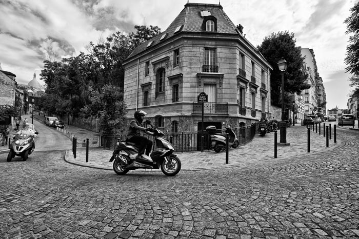 Photo of scooters in cobblestone street in Paris, France by Randy Romano
