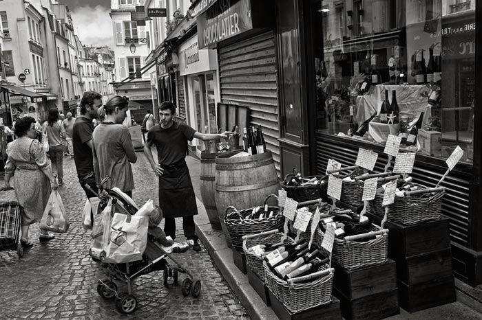 Photo of wine vendor on street in Paris, France by Randy Romano