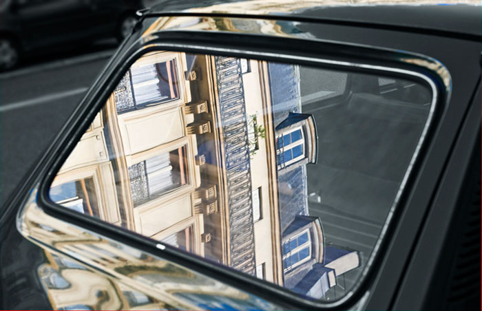 Reflection photo in car window in Paris, France by Randy Romano