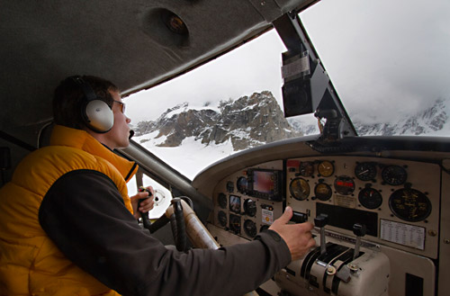 Photo of pilot landing Talkeetna Air Taxi on glacier of the Alaskan Mountain Range by Barry Epstein