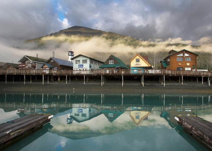 Reflection photo of buildings on Seward, Alaska pier by Barry Epstein