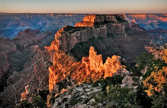 Autumn color photo at sunrise from north rim of Grand Canyon, Arizona by Robert Hitchman