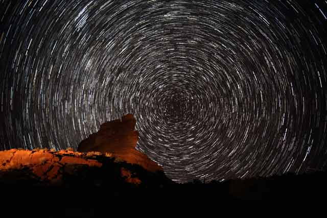 Star Stacking: Light painted on forground rock formations and stars in circular pattern at Valley of the Gods, Utah by Andy Long.