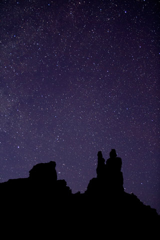 Star photography: image of stars at twilight with silhouetted rock formations at Valley of the Gods, Utah by Andy Long.