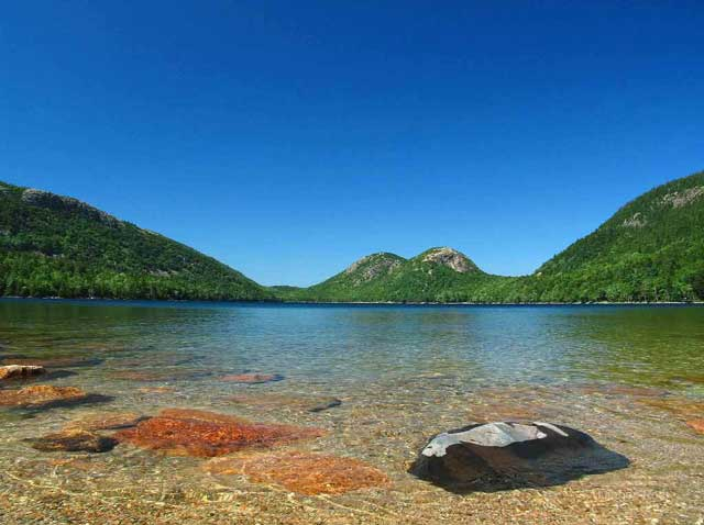 Acadia National Park, Maine: clear waters of Jordan Pond with the Bubbles (hills) in the background by Juergen Roth.