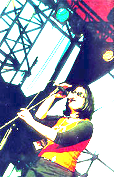 Over exposed color image of Cindy Ryan on stage by Lisa J. Young.