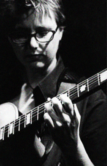 Black and white images of Sam Harley performing on his guitar by Lisa J. Young.
