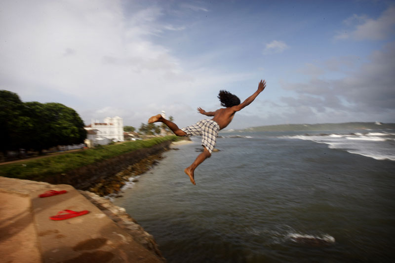 Photo of young man jumping into the sea-- Sri Lanka by Marielle van Uitert