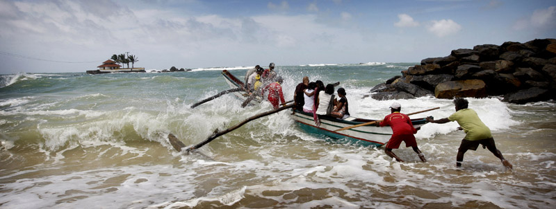 Photo of boat launching on the shores in Hikkaduwa by Marielle van Uitert