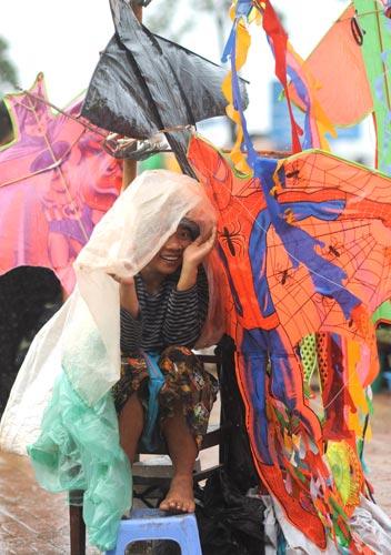 Photo of woman selling kites, Phnom Penh, Cambodia by Ron Veto