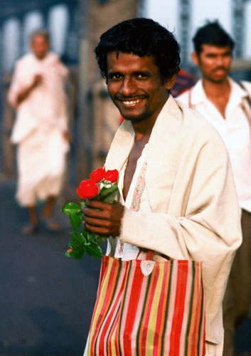 Photo of man with flowers in Calcutta, India by Ron Veto