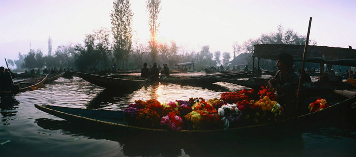 Photo of floating market at sunrise in Dal Lake, Kashmir by Ron Veto