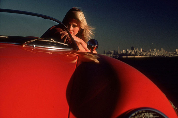 Photo of woman in red Porsche by Gert Wagner