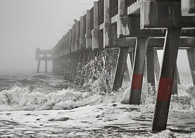 Black and white photo of the Jacksonville Beach, Florida pier in the fog by Marla Meier.