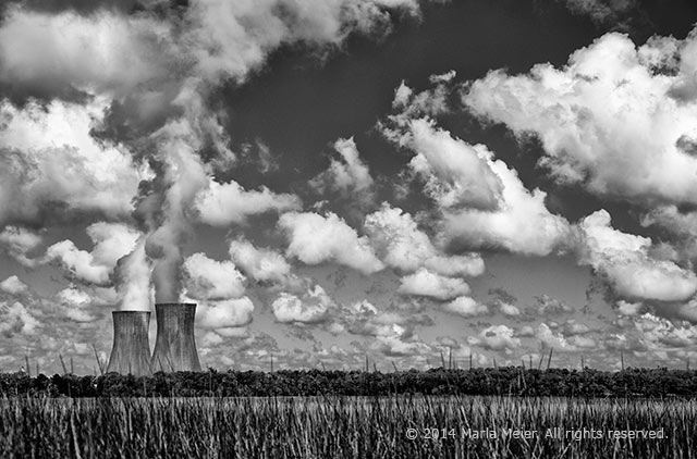 Black and white whimsical photo of cooling towers making clouds by Marla Meier.