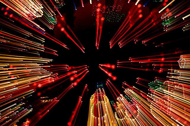 Photo of Christmas lights made while zooming the camera lens by Noella Ballenger.
