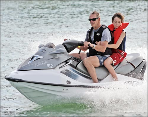 Photo of man and boy on jet ski from Emotion in Motion ebook by Jim Austin