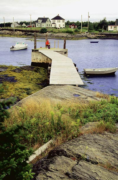 "Photo of boardwalk in community of ""Blue Rocks"" in Lumenburg, Nova Scotia by Mike Goldstein"