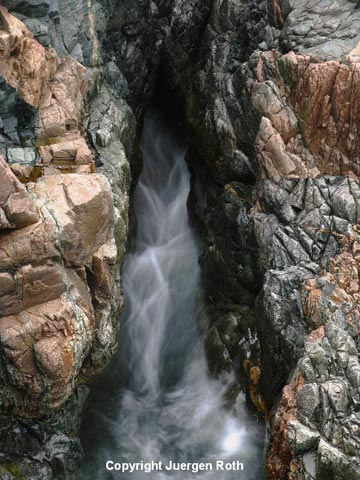 Photo of water streaming from rocks at Granite Coast near Thunder Hole by Juergen Roth.