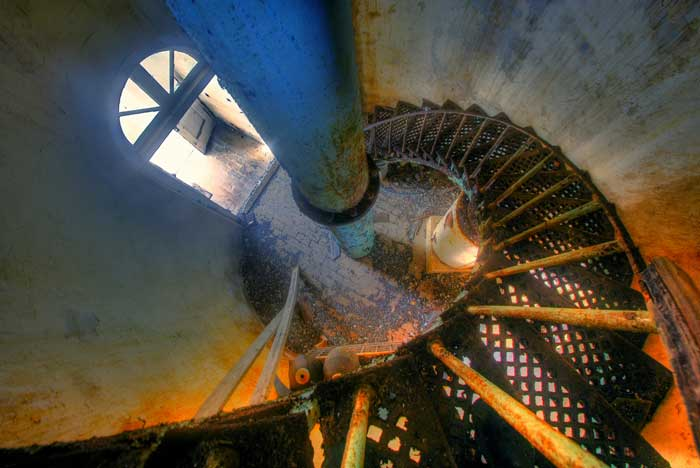 HDR image of winding metal staircase inside the Bird Rock Cay Lighthouse on Crooked Island in the Bahamas by Jim Austin