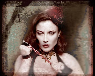 Sepia toned photo of female model with red hat and chain from the grunge series by hybrid model photographer Juul de Vries.