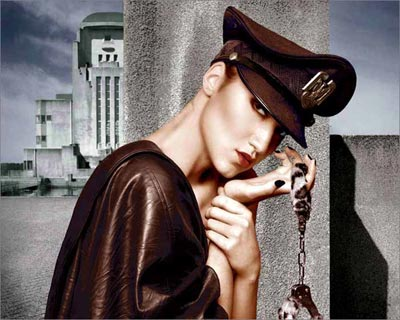 Photoshop colored photo of female model dressed in retro style leather jacket with handcuffs from the retro series by Juul de Vries.