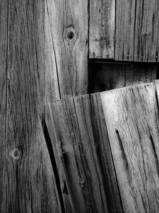 Backyard Photography: Black and white close-up photo of broken wood on the side of a barn by Randall Romano