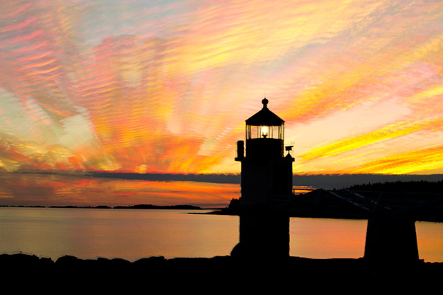 A sunset photo with many colors surrounds the Marshall Point Lighthouse in Rockland, Maine created by stacking 29 images by Andy Long.