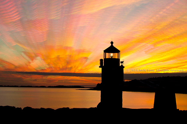 Cloud Stacking in Photography - A colorful sunset image of the Marshall Point Lighthouse in Rockland, Maine