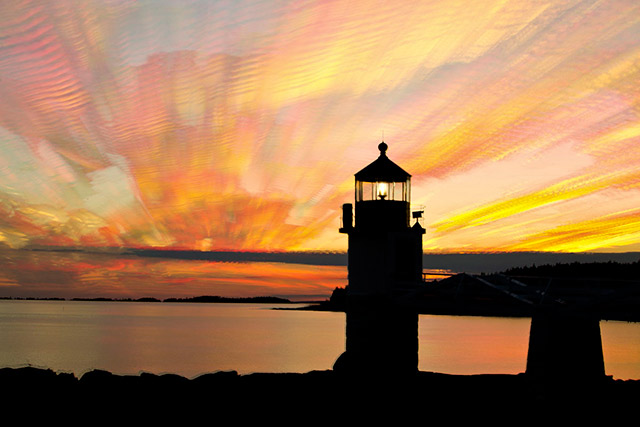 A colorful sunset image of the Marshall Point Lighthouse in Rockland, Maine created by stacking 57 images by Andy Long.