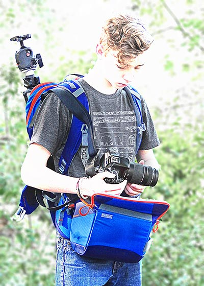 Image of a photographer using the rotating beltpack of the MindShift Gear's rotation180°® Trail™Backpack by Marla Meier.