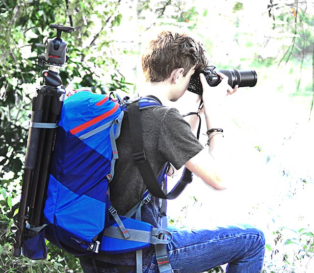 Image of a photographer using the MindShift Gear's rotation180°® Trail™Backpack by Marla Meier.